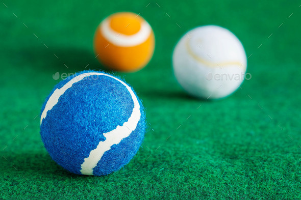 tennis balls on lawn - Stock Photo - Images