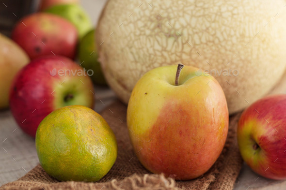 apples and oranges on sackcloth - Stock Photo - Images