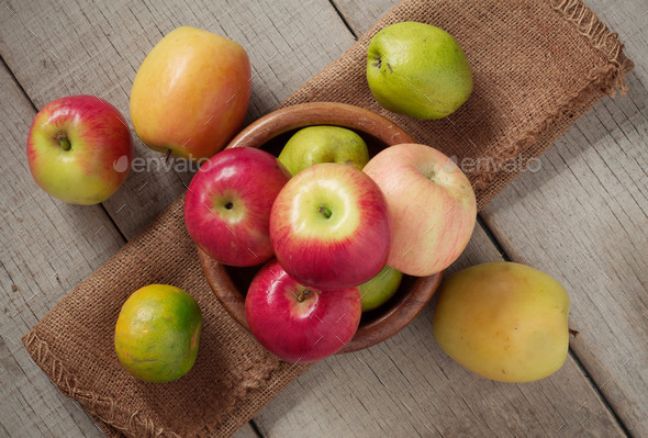 Apples in a bowls on wooden - Stock Photo - Images