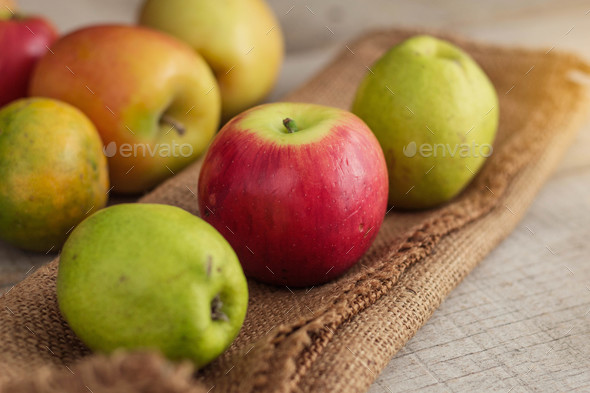 apples on sackcloth - Stock Photo - Images