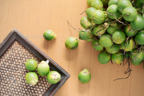 betel nut and tray on wooden - Stock Photo - Images