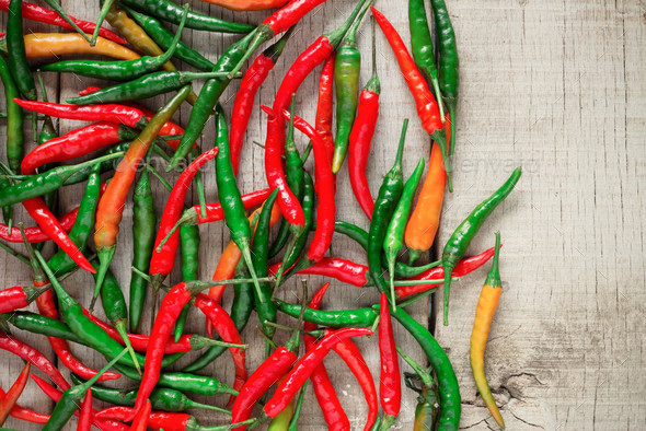 Fresh chilies on wooden floor - Stock Photo - Images