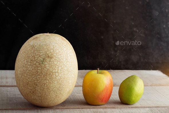 Melon and apples on the old wooden - Stock Photo - Images