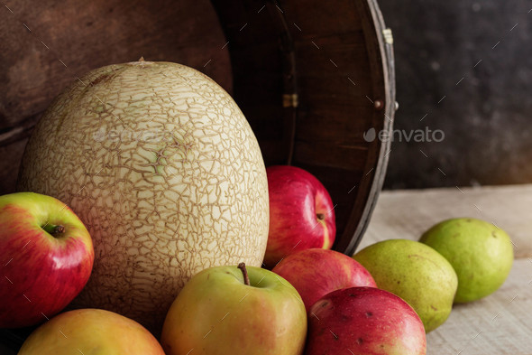 Melon and other fruits on wooden - Stock Photo - Images