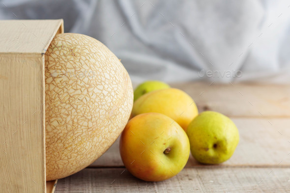 Melon on wooden floor - Stock Photo - Images