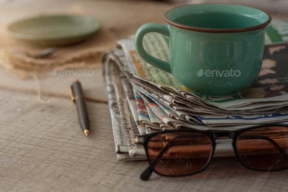 Newspapers on wooden floor - Stock Photo - Images