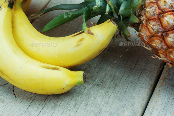 Banana and pineapple on wooden - Stock Photo - Images