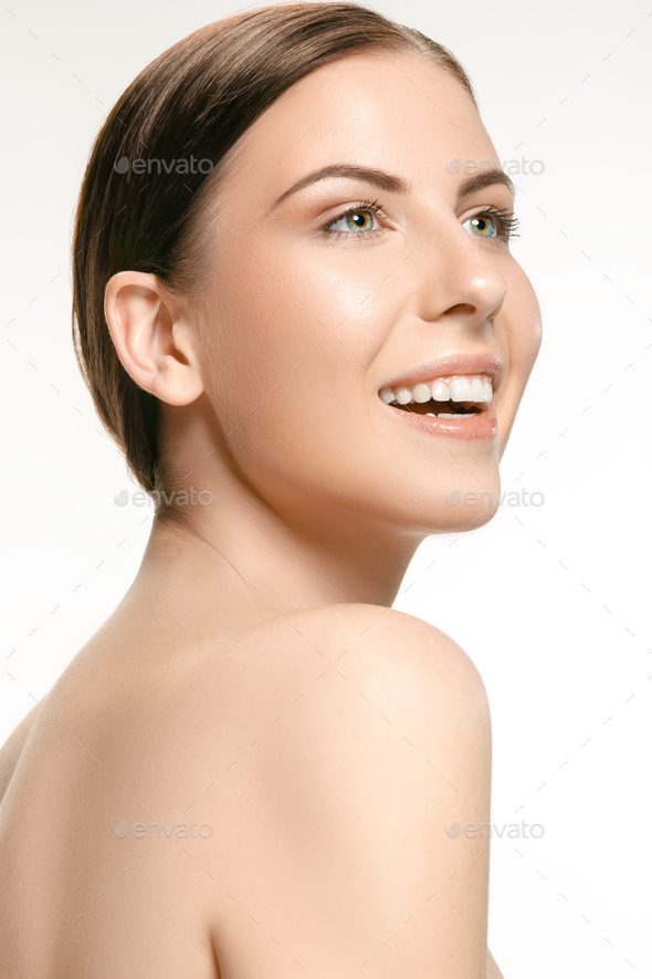 Beautiful face of young adult woman with clean fresh skin isolated on white - Stock Photo - Images
