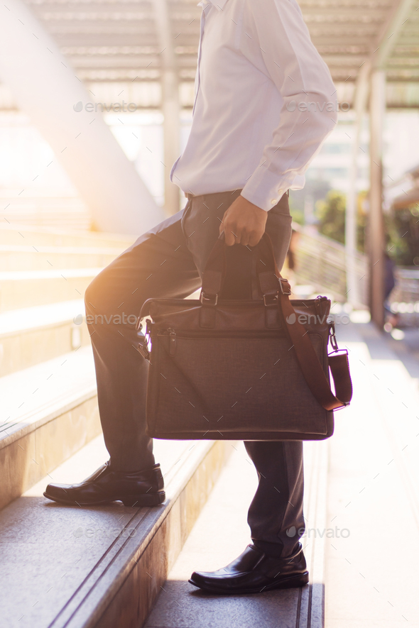business man walking up stairs - Stock Photo - Images