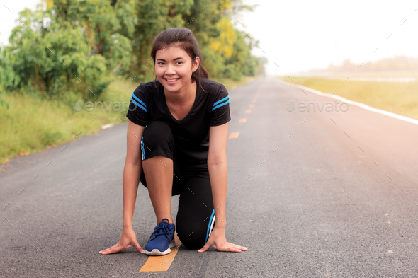 Girl is preparing to run - Stock Photo - Images