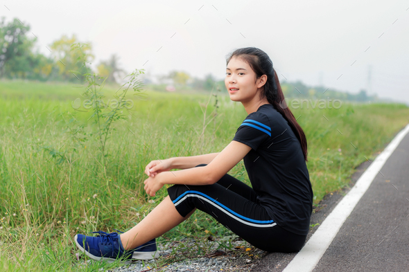 Girl is sitting on road - Stock Photo - Images