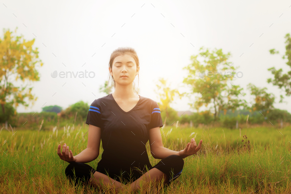 Girl is sitting on grass - Stock Photo - Images