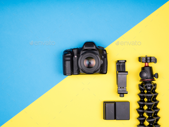 Flat lay top view of camera with accessories - Stock Photo - Images