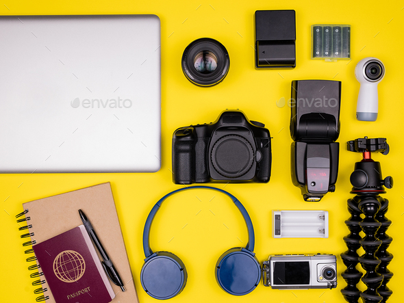 Top view flat lay of traveler accessories on yellow background - Stock Photo - Images