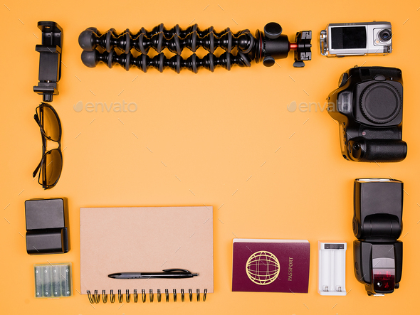 Flatlay accesories of a travel blogger on pastel orange background - Stock Photo - Images