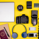 Top view flat lay of traveler accessories on yellow background - PhotoDune Item for Sale