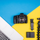 Camera with accessories next to a laptop - PhotoDune Item for Sale