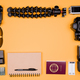 Flatlay accesories of a travel blogger on pastel orange background - PhotoDune Item for Sale
