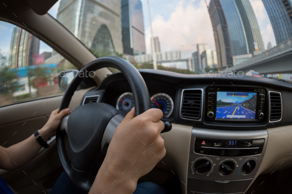 Driving car in city - Stock Photo - Images