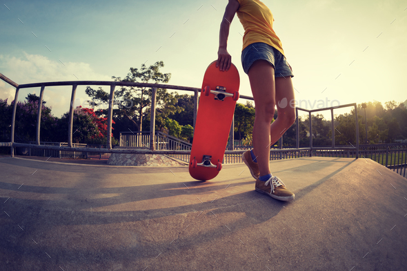 Young woman skateboarder at skatepark - Stock Photo - Images