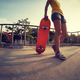 Young woman skateboarder at skatepark - PhotoDune Item for Sale