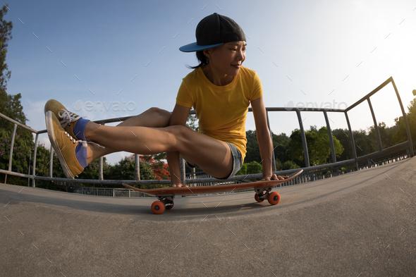 Practice yoga on skateboard at skatepark - Stock Photo - Images