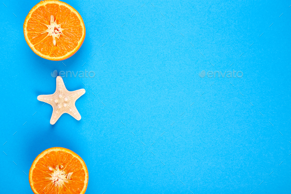Summer concept. Orange fruit and starfish - Stock Photo - Images