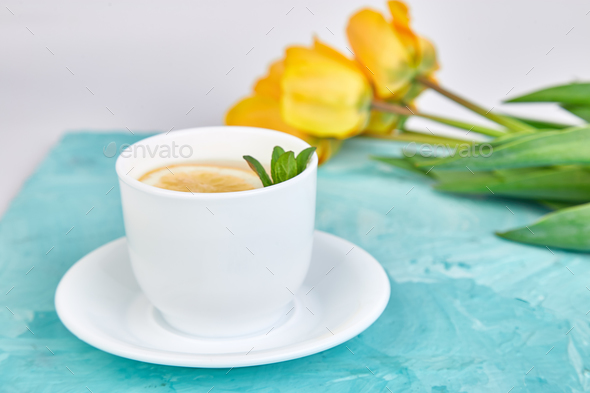 White cup of tea with lemon - Stock Photo - Images