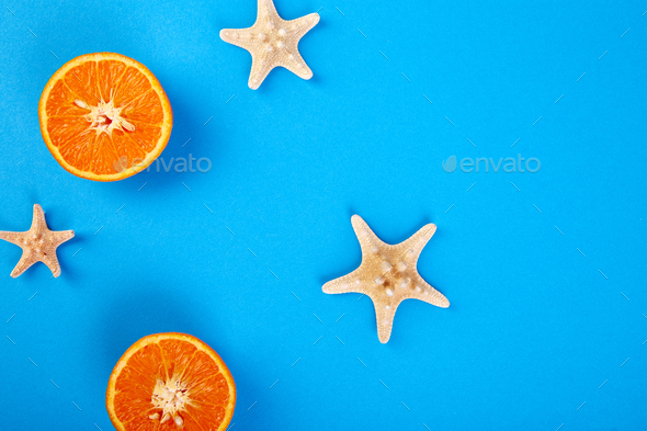 Summer concept. Orange fruit and starfish - Stock Photo - Images