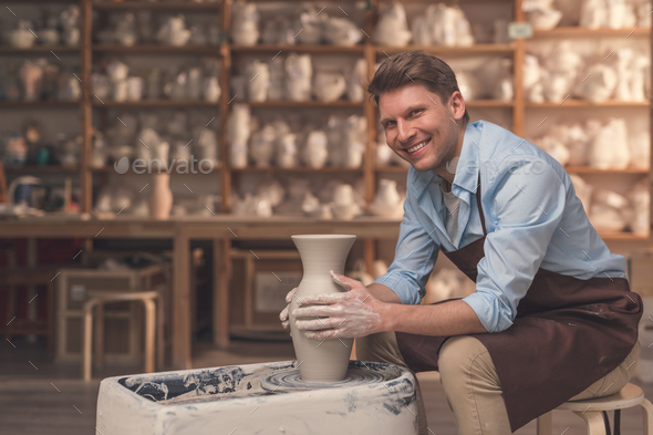 Smiling man at the potter's wheel - Stock Photo - Images