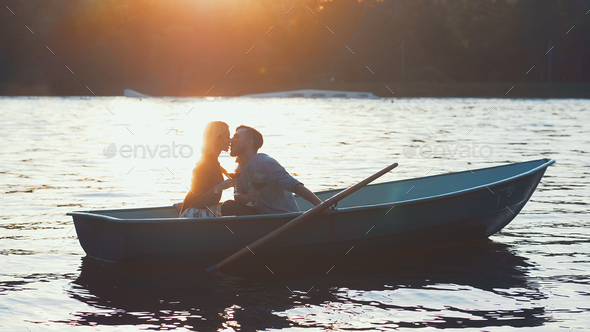 Kissing couple in a boat - Stock Photo - Images
