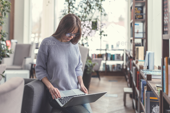 Working young girl with laptop - Stock Photo - Images