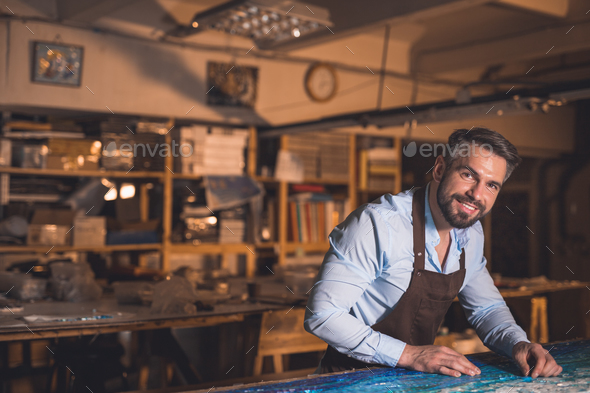 Smiling master at artwork - Stock Photo - Images