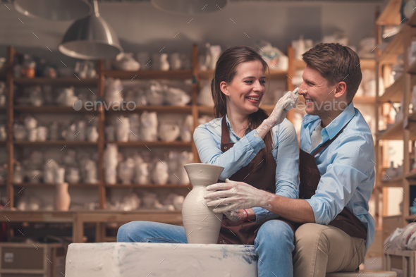 Young couple in pottery - Stock Photo - Images