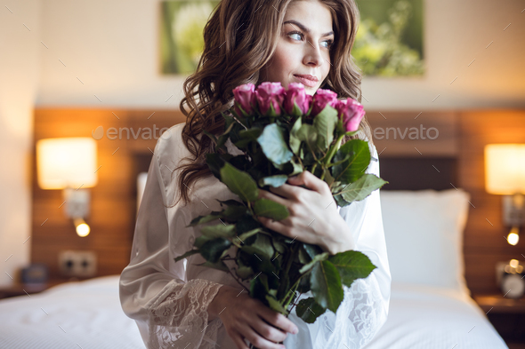 Beautiful youna girl with a bouquet of flowers - Stock Photo - Images