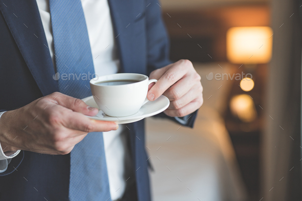 Young businessman with a cup of coffee - Stock Photo - Images