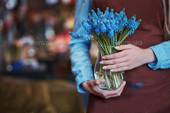 Young girl with flowers - Stock Photo - Images