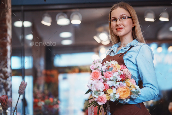 Attractive young girl with bouquet - Stock Photo - Images