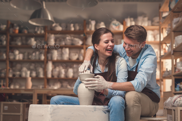 Happy couple at the potter's wheel - Stock Photo - Images