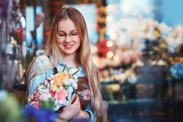 Smiling young girl with bouquet - Stock Photo - Images