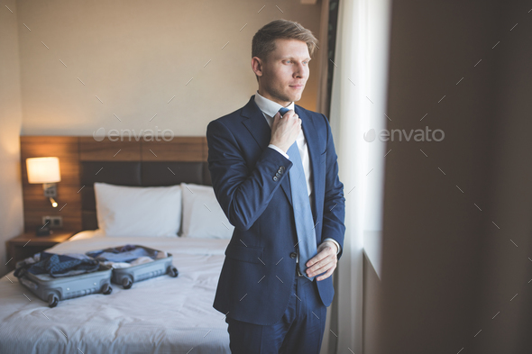 Young businessman in suit in room - Stock Photo - Images