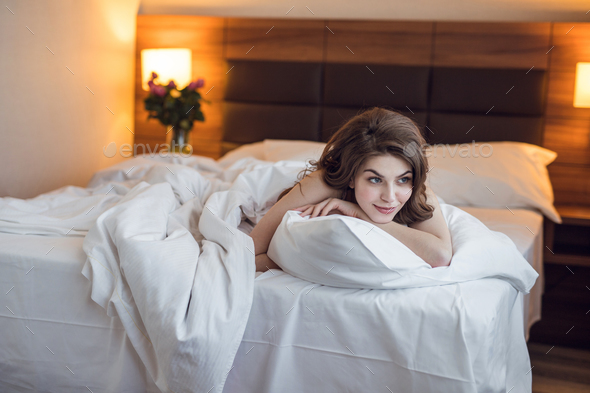 Attractive young girl in bedroom - Stock Photo - Images
