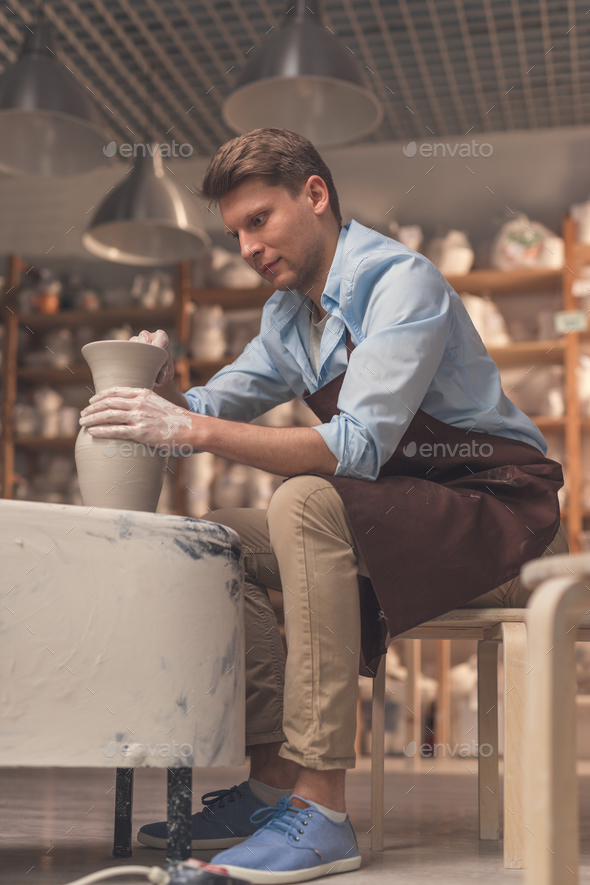 Young man in apron - Stock Photo - Images