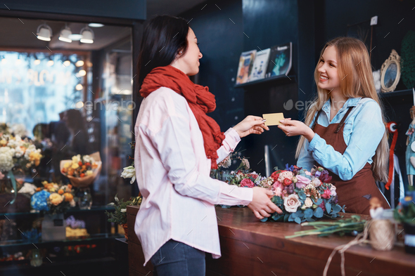 Young girl buying a bouquet of flowers - Stock Photo - Images