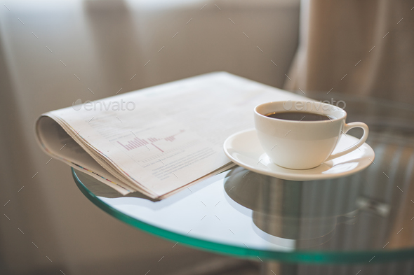 A cup of coffee and a newspaper - Stock Photo - Images