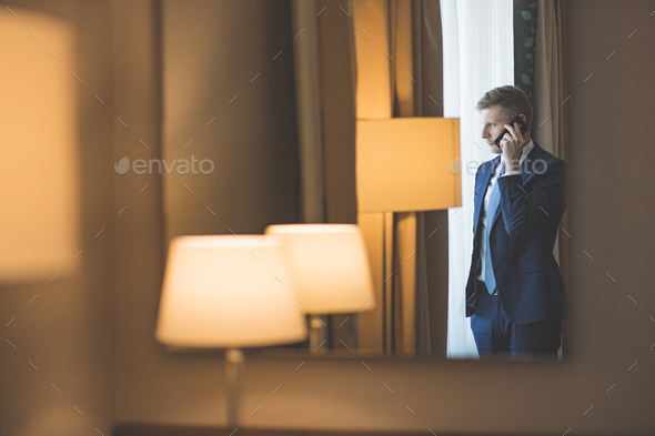 Smiling man talking on a phone - Stock Photo - Images