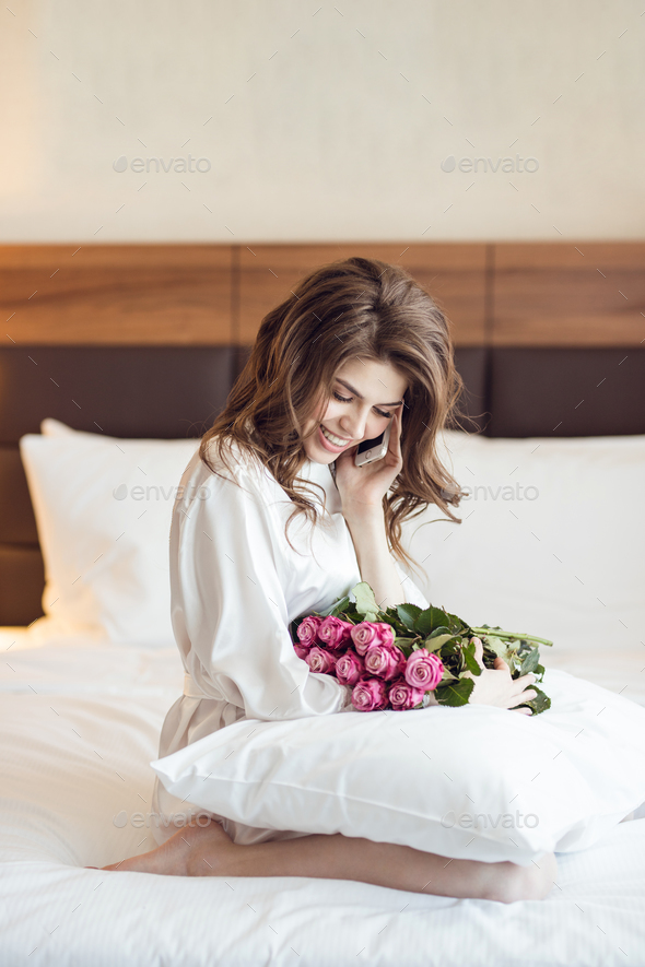 Beautiful woman with a bouquet of flowers - Stock Photo - Images