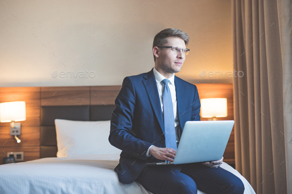 Young businessman with laptop in the hotel - Stock Photo - Images