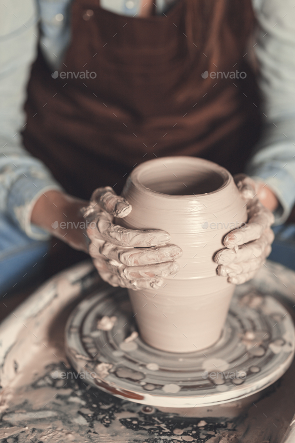 Young woman in pottery - Stock Photo - Images
