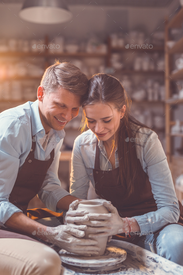 Smiling couple at the potter's wheel - Stock Photo - Images